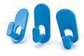 Three blue plastic wall hook hangers Stock Image