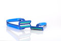 Three blue razors over white shallow dof Royalty Free Stock Photos