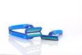 Three blue razors over white shallow dof Royalty Free Stock Photos