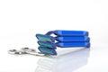 Three blue razors and scissors Royalty Free Stock Photo