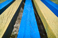 Three blue and two yellow planks convergent Royalty Free Stock Images