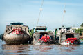 Three boats with red prow in the floating market in the mekong delta vietnam Stock Photos