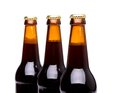 Three bottles of beer isolated on a white bacground Stock Photo