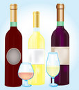 Three bottles blame and goblets Royalty Free Stock Image