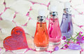 Three bottles of floral fragrance perfume Royalty Free Stock Photo