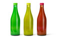 Three Bottles of Fruit Juices Stock Photos
