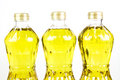 Three bottles oil of refined palm olein from pericarp isolated Stock Photos