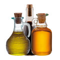 Three bottles of olive oil and vinegar isolated on white background Royalty Free Stock Photos