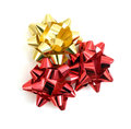 Three bow to decorate gifts red and two gold Royalty Free Stock Photography