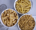 Three bowls of dried pasta white Stock Image