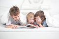 Three boy read book indoors Stock Photo
