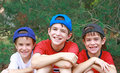 Three Boys in Baseball Hats Stock Images
