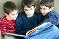 Three Boys Reading Stock Images