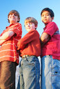 image photo : Three boys standing arms crossed