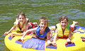 Three Boys Tubing Royalty Free Stock Photo