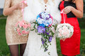 Three bridesmaids holding bouquets Royalty Free Stock Photo
