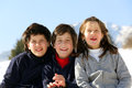 Three brothers in the mountains on snow in winter Royalty Free Stock Photo