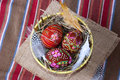 Three brown painted easter eggs straw plate kind top Stock Photo