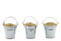 Three buckets filled with sand Royalty Free Stock Photo