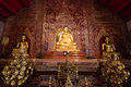 Three Buddha images sitting inside Wat Phra Singh, Thailand Royalty Free Stock Photo