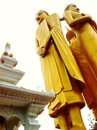 Three buddha images standing elegantly on the naga angel in front of image Royalty Free Stock Photography
