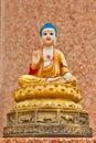 Three Buddha statue sitting on a wall Royalty Free Stock Image