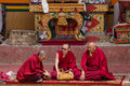 Three buddhist monk during mystical mask dancing in festival at Lamayuru Gompa, Ladakh, North India