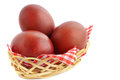Three burgundy eggs basket birch bark Stock Image
