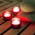 Three burning candles with zen stones Stock Image