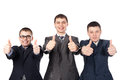 Three business men giving thumbs up sign Royalty Free Stock Images