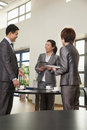 Three business people meeting in company cafeteria Royalty Free Stock Photo