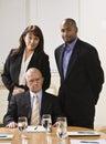 Three business people posing. Royalty Free Stock Photo