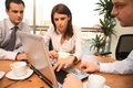 Three business persons  working together with laptop in sunny office Royalty Free Stock Image