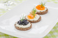 Three canapes with salmon and caviar Royalty Free Stock Photos