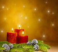 Three candles in a festive Christmas setting Stock Images