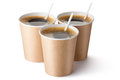 Three cardboard vending coffee cups standing on a white Royalty Free Stock Photos