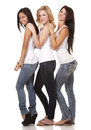 Three casual women beautiful having fun on white background Stock Image