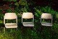 Three chairs in garden Royalty Free Stock Photography