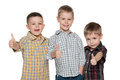 Three cheerful cute boys little are standing together on the white background Stock Photography
