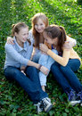 Three cheerful student girls Stock Photography