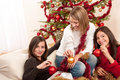 Three cheerful women having fun on Christmas Royalty Free Stock Image