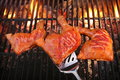 Three Chicken Leg Quarter Roasted On Hot Charcoal Flaming Grill Royalty Free Stock Photo