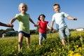 Three children running holding hands Royalty Free Stock Photo