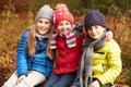 Three Children On Walk Through Winter Woodland Royalty Free Stock Photo