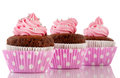 Three Chocolate cupcakes with pink butter icing Royalty Free Stock Photo