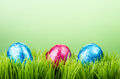 Three chocolate foil Easter eggs on grass Stock Photography