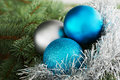 Three christmas ball on a tree green Stock Photo