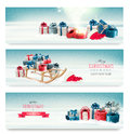 Three Christmas banners with presents and a sleigh. Royalty Free Stock Photo