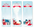 Three Christmas banners with presents. Royalty Free Stock Photo