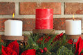 Three Christmas candles Stock Photos